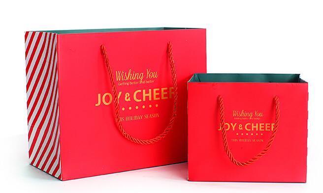 红色时尚化妆品白卡纸袋定制