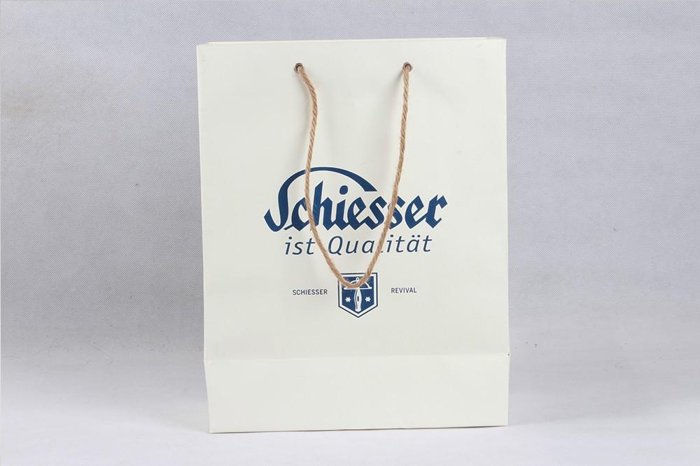 高档白色字母铜版纸袋