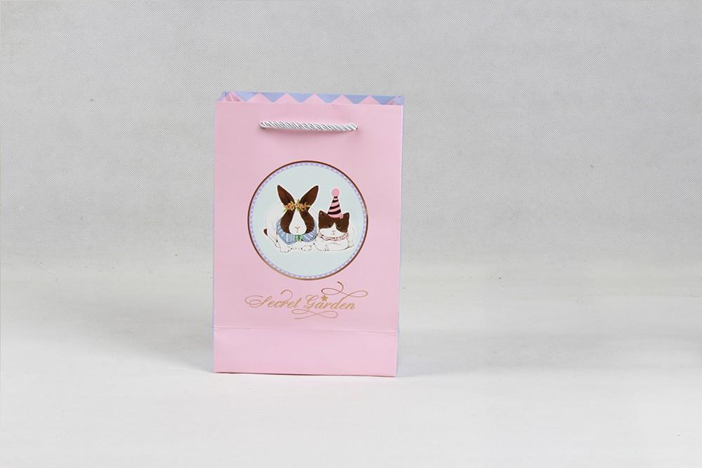粉色卡通礼品白卡纸袋