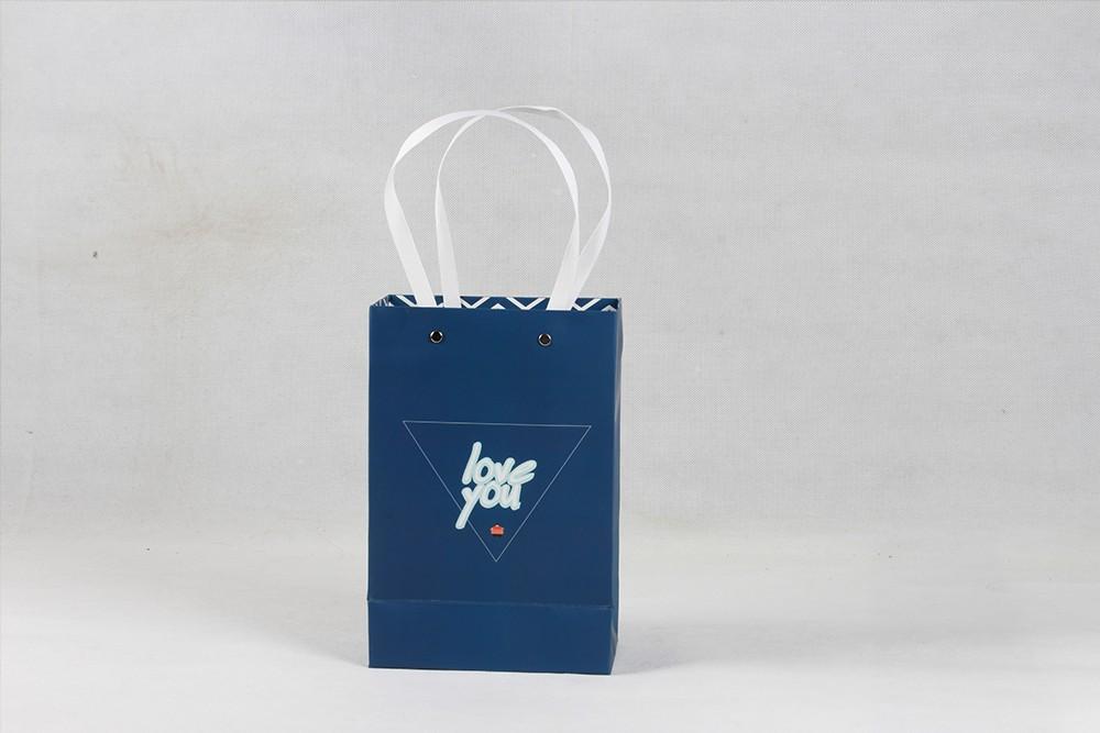 蓝色高端白卡纸袋
