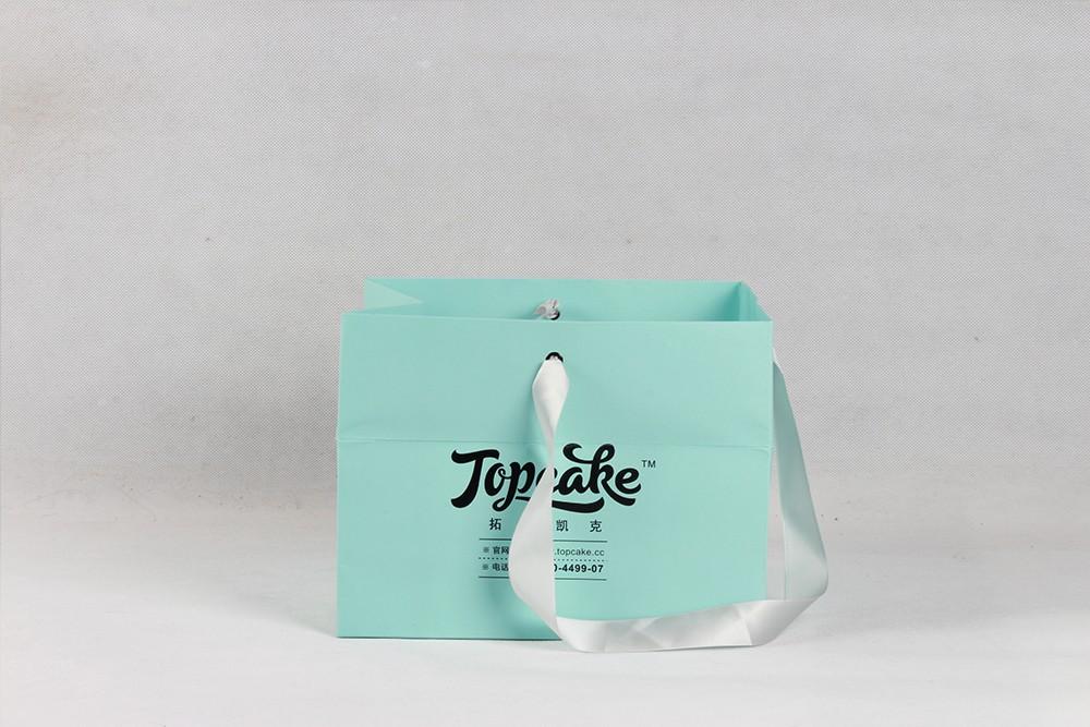 薄荷绿清新型白卡纸袋  拓普凯克